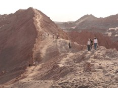Tours of Valle de la Luna end with people hiking up a giant sand dune and picking out a spot to view the sunset.