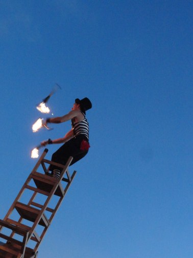 Street performers do all kinds of crazy stunts on Mallory Square.