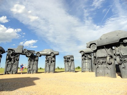 Tourist trap of the day, Carhenge! Just outside Alliance, Nebraska, vintage cars have been arranged in the same layout as the English original. Why? Why not?