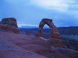 We entered Arches National Park in the dark of night in the rain to arrive at Delicate Arch by sunrise. The place is crowded at sunset, but we almost had it to ourselves at 6:00am.
