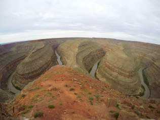 Utah's Goosenecks State Park is a high viewpoint where you look down on an extremely twisty canyon formed by the San Juan River.