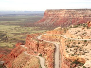 This is the Moki Dugway section of Utah Highway 261. It's a normal paved highway except for a 3-mile section where it becomes gravel and climbs 1,200 feet up a mesa. Totally unexpected.