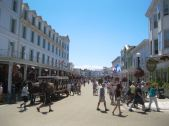 Mackinac Island is a popular tourist destination and is famous for not having any cars. All visitors arrive by boat and get around the island on foot, in a horse-drawn carriage or on bikes.