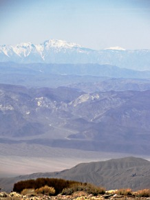 Looking west from Wildrose Peak gives views of the distant and very tall Sierra Nevada range, home to Mt. Whitney, the highest point in the Lower 48.