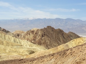 The view toward the Panamint Mountains from Golden Canyon Trail. Wildrose Peak is the rounded mountain with three tiny dots of snow on the right, Telescope Peak is the high point.