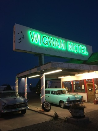 Neon and strategically-placed vintage cars complete the ambiance.