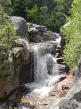 Screw Auger Falls is a great place to wade in the cool creek.