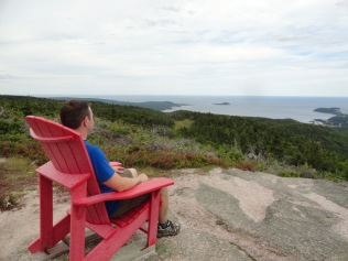 Parks Canada's signature red chair on top of Franey Mountain, Cape Breton Highlands National Park.
