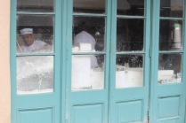 Back windows of Cafe du Monde. Powdered sugar galore!