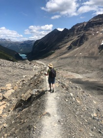 Heading back down the ridge of a moraine. That's Lake Louise in the distance.
