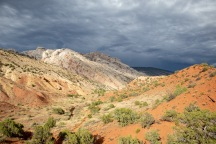 "Ominous skies over the colorful ""Desert Voices Nature Trail"" at Dinosaur NM."