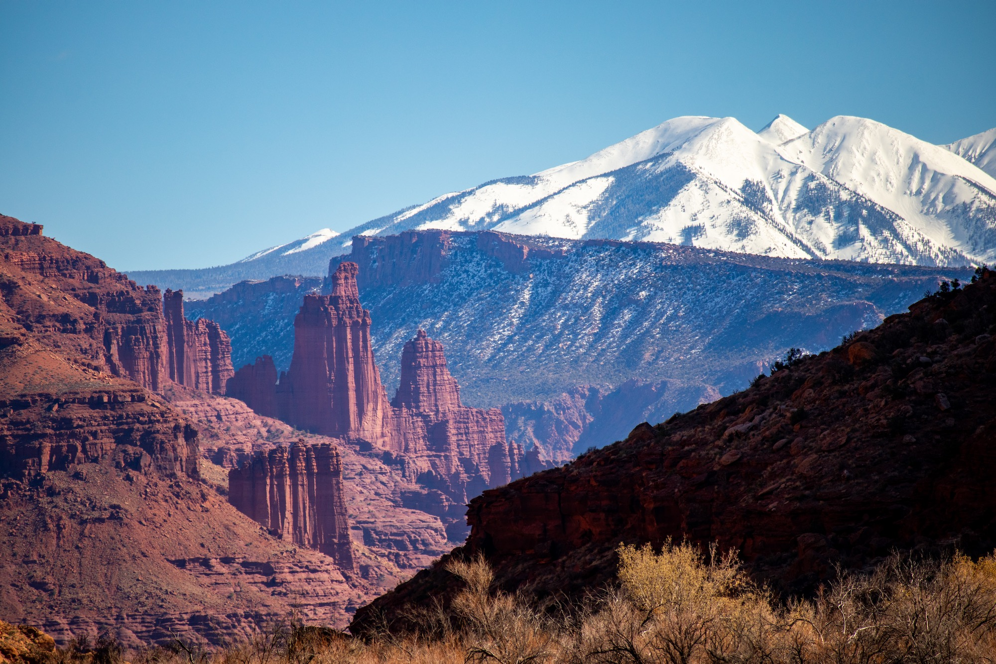 Fisher Towers and the La Sal Mountains viewed from the Utah 128 scenic byway.