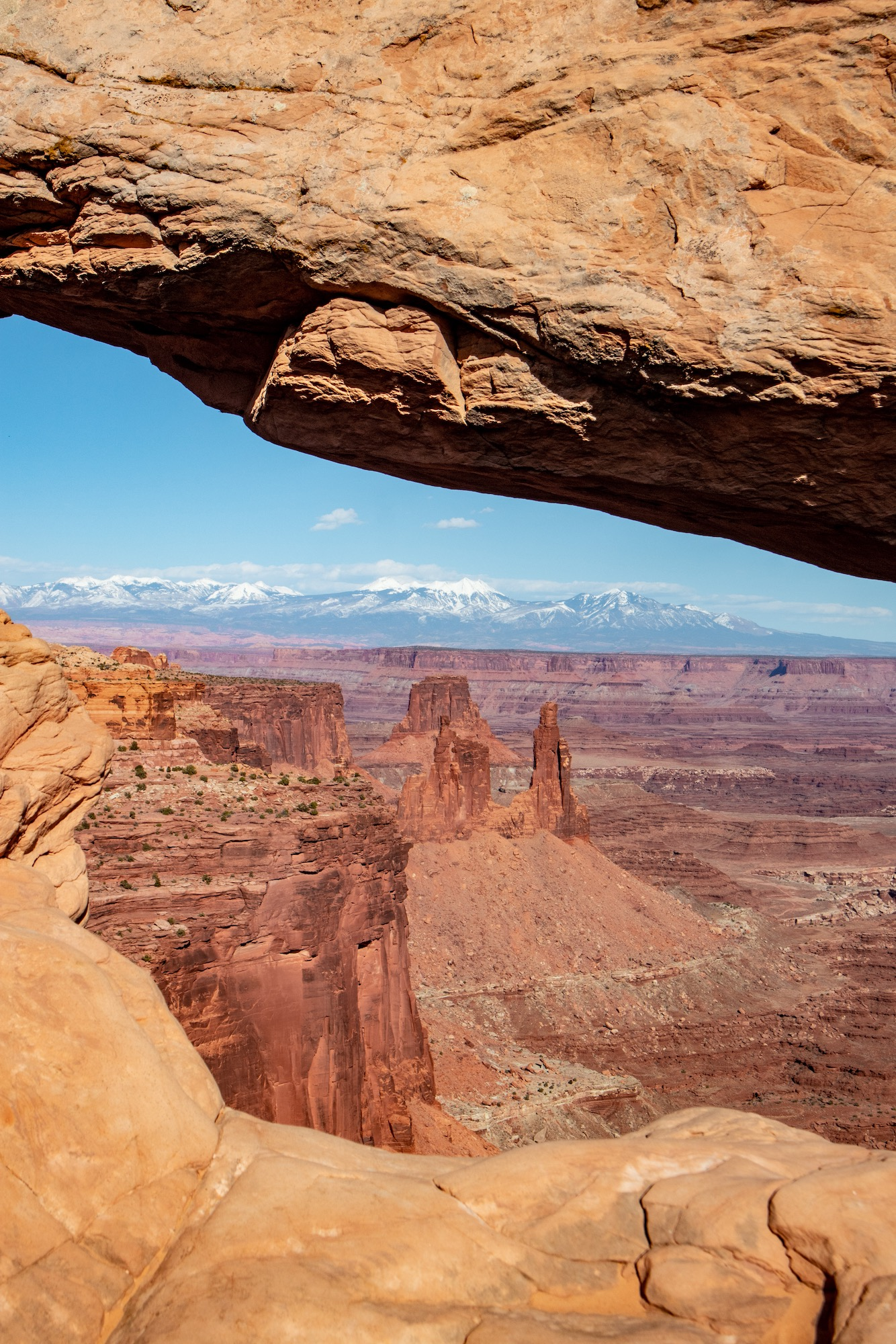 Looking through Mesa Arch toward Washerwoman Arch and Airport Tower.