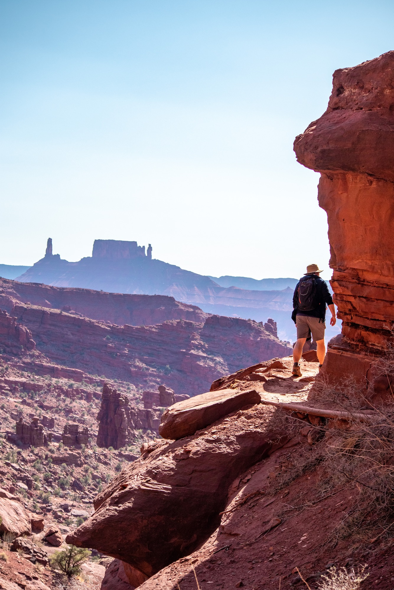 Hiking around the base of Fisher Towers, Castleton tower in the distance.