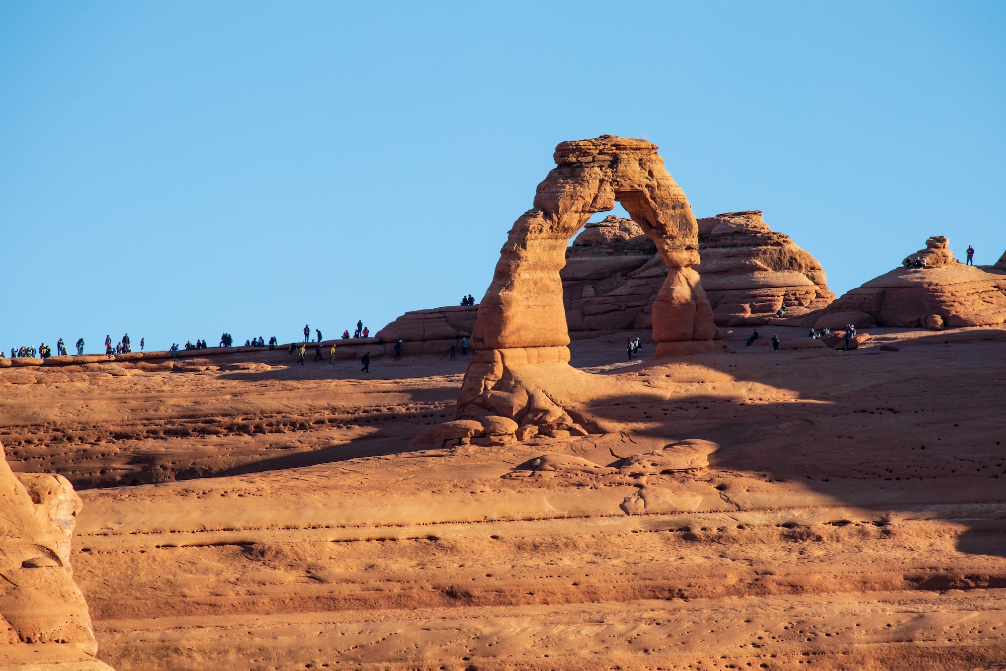 Delicate Arch viewed from the lower viewpoint. Notice the large crowd gathering already.